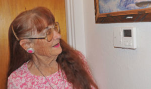 """Bessie Burr of Rifle received a furnace tune-up, a programmable thermostat and air sealing throughout her home. The upgrades reduced her home energy bill by $20 a month. """"I didn't even turn on my air conditioning last summer,"""" Burr said. Photo by Kelley Cox"""