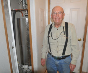 Garry Evenson of Battlement Mesa received a tight, insulating wrapping on his hot water heater, along with air sealing, LED light bulbs, furnace tune-up and a low-flow showerhead. Photo by Kelley Cox