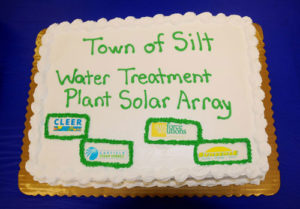 Silt's town government staff ordered a specially decorated cake to celebrate the completion of the water treatment plant solar array.